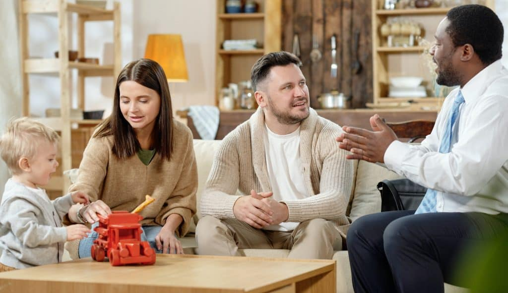Young family having consultation with real estate agent